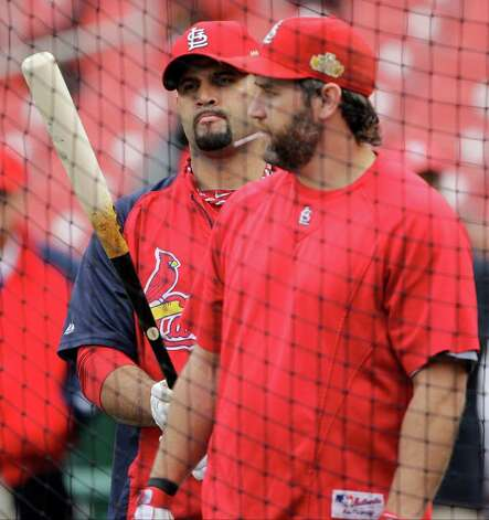 St. Louis Cardinals' Albert Pujols, left, and Lance Berkman wait to hit during batting practice before Game 6 of baseball's World Series against the Texas Rangers Thursday, Oct. 27, 2011, in St. Louis. (AP Photo/Paul Sancya) Photo: Associated Press