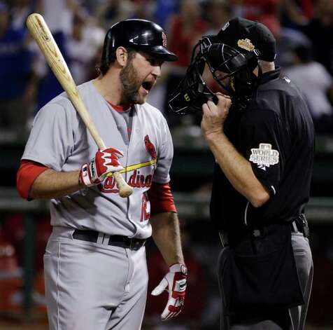 St. Louis Cardinals' Lance Berkman argues with home plate umpire Ron Kulpa after striking out during the seventh inning of Game 4 of baseball's World Series against the Texas Rangers Sunday, Oct. 23, 2011, in Arlington, Texas. (AP Photo/Matt Slocum) Photo: Associated Press