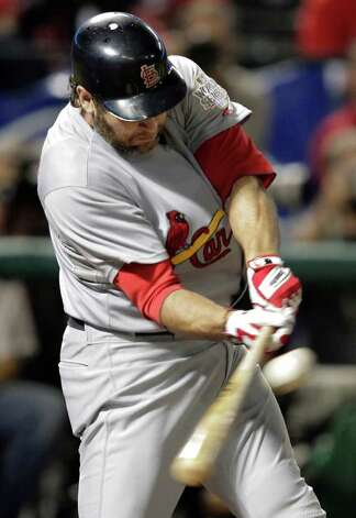St. Louis Cardinals' Lance Berkman hits a double during the second inning of Game 4 of baseball's World Series against the Texas Rangers Sunday, Oct. 23, 2011, in Arlington, Texas. (AP Photo/Charlie Riedel) Photo: Associated Press