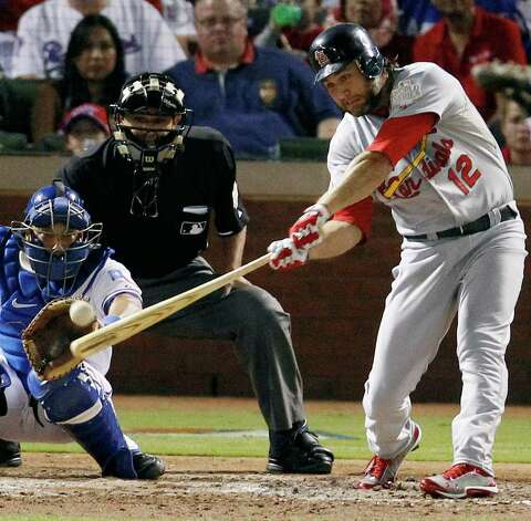 St. Louis Cardinals' Lance Berkman singles Texas Rangers' Matt Harrison during the fourth inning of Game 3 of baseball's World Series Saturday, Oct. 22, 2011, in Arlington, Texas. (AP Photo/Eric Gay) Photo: Associated Press
