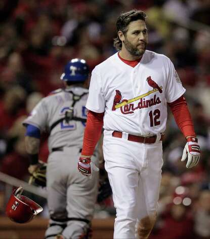 St. Louis Cardinals' Lance Berkman (12) reacts after striking out during the sixth inning of Game 2 of baseball's World Series against the Texas Rangers Thursday, Oct. 20, 2011, in St. Louis. (AP Photo/Charlie Riedel) Photo: Associated Press