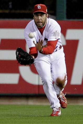 St. Louis Cardinals' Lance Berkman catches a line drive off the bat of Texas Rangers' Mike Napoli during the fifth inning of Game 2 of baseball's World Series Thursday, Oct. 20, 2011, in St. Louis. (AP Photo/Matt Slocum) Photo: Associated Press