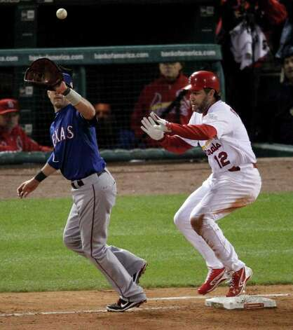St. Louis Cardinals' Lance Berkman beats the throw to Texas Rangers' Michael Young at first base during the eighth inning of Game 1 of baseball's World Series Wednesday, Oct. 19, 2011, in St. Louis. (AP Photo/Jeff Roberson) Photo: Associated Press