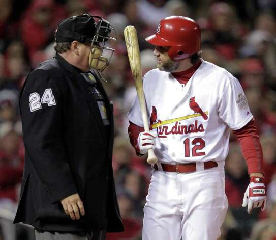 St. Louis Cardinals' Lance Berkman argues a call with umpire Jerry Layne during the sixth inning of Game 1 of baseball's World Series against the Texas Rangers Wednesday, Oct. 19, 2011, in St. Louis. (AP Photo/Charlie Riedel) Photo: Associated Press