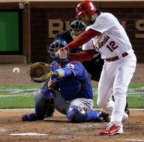 St. Louis Cardinals' Lance Berkman hits a two-run single of Texas Rangers' C.J. Wilson during the fourth inning of Game 1 of baseball's World Series Wednesday, Oct. 19, 2011, in St. Louis. (AP Photo/Jeff Roberson) Photo: Associated Press