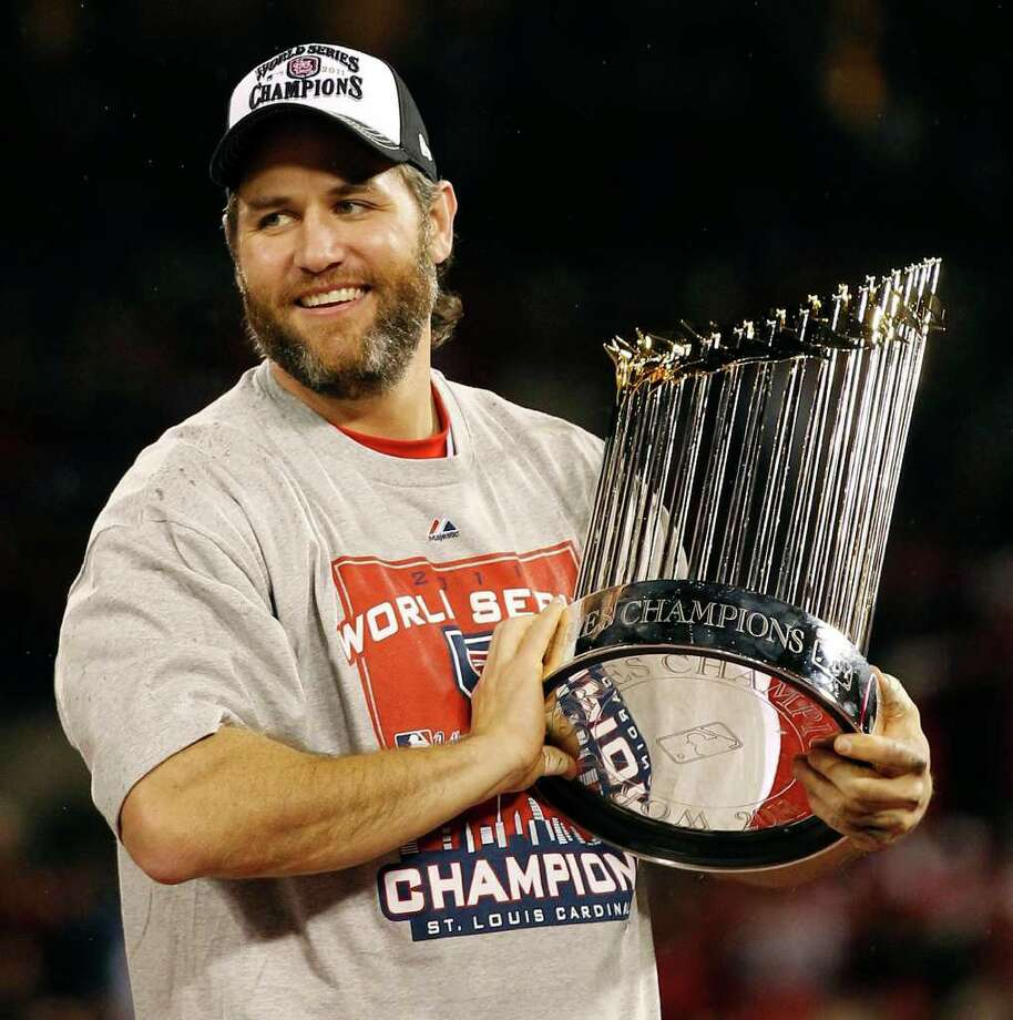 St. Louis Cardinals' Lance Berkman holds up the Commissioner's Trophy after Game 7 of baseball's World Series against the Texas Rangers Friday, Oct. 28, 2011, in St. Louis. The Cardinals won 6-2 to win the series. (AP Photo/Eric Gay) Photo: Associated Press