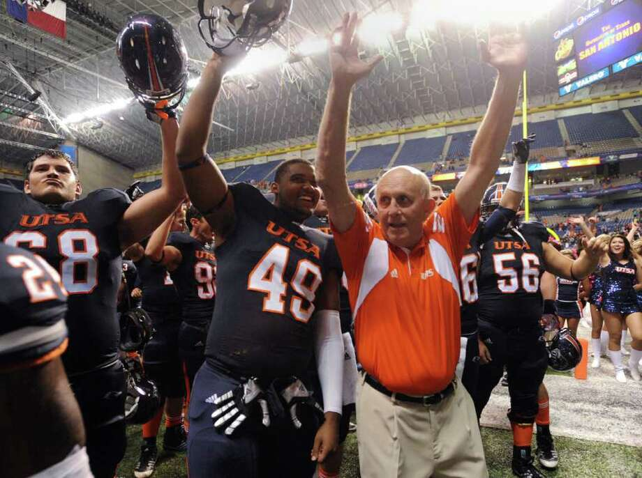 UTSA football coach Larry Coker celebrates with his team after defeating Georgia State, 17-14, in college football action at the Alamodome on Saturday, Oct. 29, 2011. BILLY CALZADA / gcalzada@express-news.net