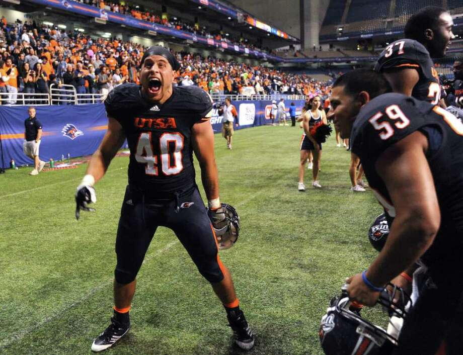 UTSA defensive end William Ritter shouts in victory after defeating Georgia State, 17-14, in overtime during college football action at the Alamodome on Saturday, Oct. 29, 2011. BILLY CALZADA / gcalzada@express-news.net