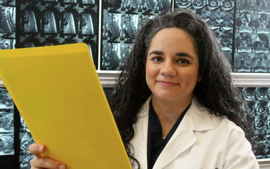 Dr. Michele Johnson, 38, is the only female neurosurgeon at Memorial Hermann's Mischer Neuroscience Institute. Photo: Gary Fountain / Copyright 2011 Gary Fountain