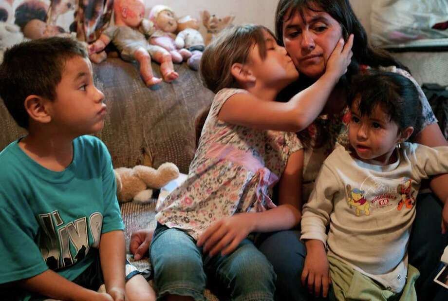 Beatriz Ramirez cares for her grandchildren, whose father was recently killed. Photo: Julian Cardona
