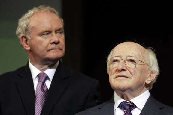 Michael D Higgins, right, and Sinn Fein's Martin McGuinness wait for the first count in the election to be next President of Ireland at Dublin Castle, Ireland, Friday, Oct. 28, 2011. (AP Photo/Peter Morrison)