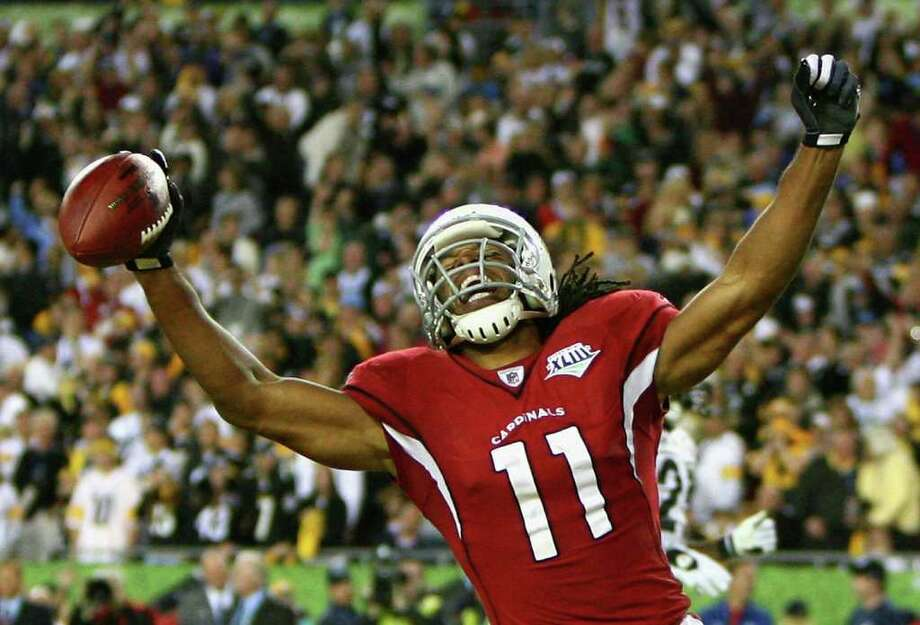 SUPER MOMENT: Even though Larry Fitzgerald and the 2008 Cardinals lost in Super Bowl XLIII, they enjoyed the run to get there. It's something three ex-Cards believe can be ahead for the Texans. Photo: Al Bello / Getty Images North America