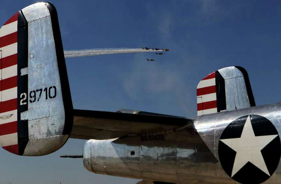 Planes fly past the tail of a B-25 bomber during the Air Show at Randolph Air Force Base Saturday October 29, 2011. JOHN DAVENPORT/jdavenport@express-news.net Photo: Express-News