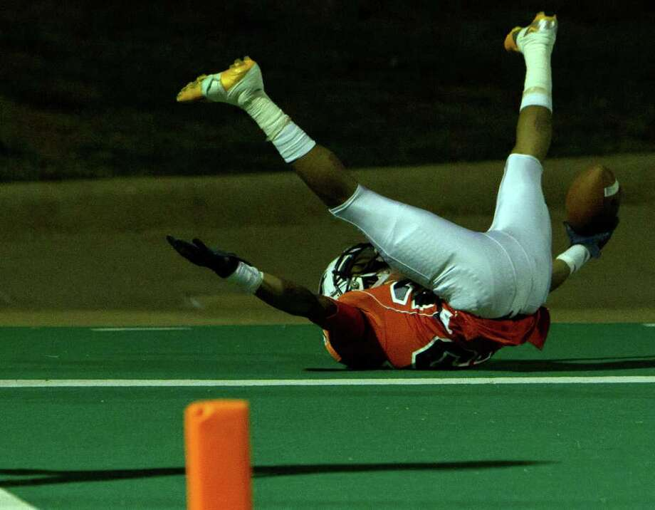 Bush wide receiver Malcom Smiley (25) tumbles in the end zone as he celebrates a long touchdown catch and run during the first quarter of a high school football game against Travis at  Mercer Stadium, Saturday, Oct. 29, 2011, in Sugar Land. Photo: Smiley N. Pool, Houston Chronicle / © 2011  Houston Chronicle