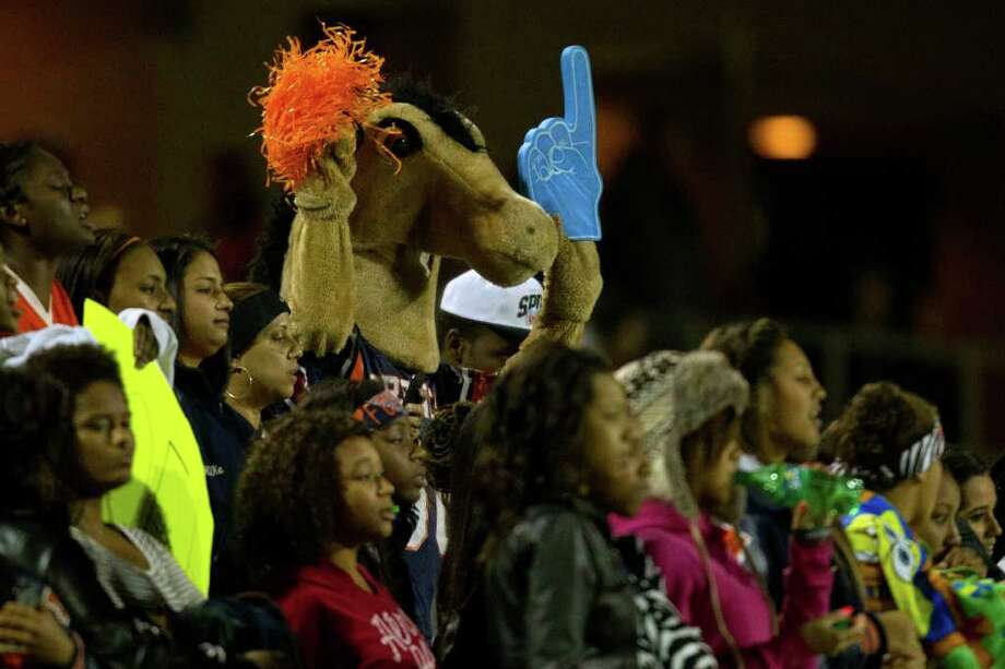 The Bush Broncos mascot joins the team's fans to cheer during them on against Travis during the first half of a high school football game at  Mercer Stadium, Saturday, Oct. 29, 2011, in Sugar Land. Photo: Smiley N. Pool, Houston Chronicle / © 2011  Houston Chronicle
