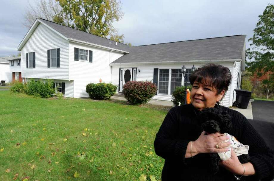 Angela Renna in front of her home in Troy, N.Y. October 21, 2011.      (Skip Dickstein/Times Union) Photo: Skip Dickstein / 2011