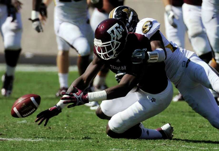 Texas A&M wide receiver Jeff Fuller, left, loses the ball under pressure from Missouri defensive back E.J. Gaines for an incomplete pass last year in College Station. Missouri won in overtime 38-31. Photo: AP