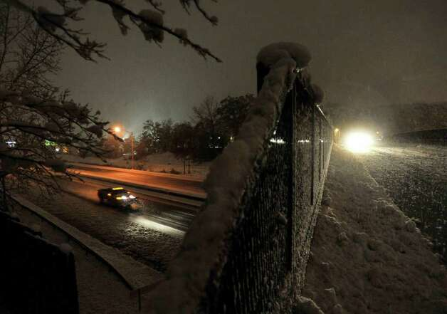 Cars travel along Interstate 84 eastbound, left, and Kenosia Avenue, right, during the snow storm on Saturday, Oct. 29, 2011. Photo: Jason Rearick
