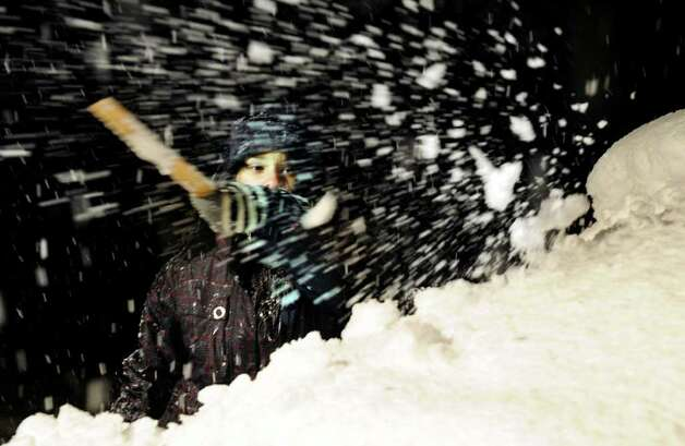 Rebekah Fields, 14, clears snow from her mother's car Saturday night on Allen Road in Brookfield.  Photo taken Saturday, Oct. 29, 2011. Photo: Carol Kaliff