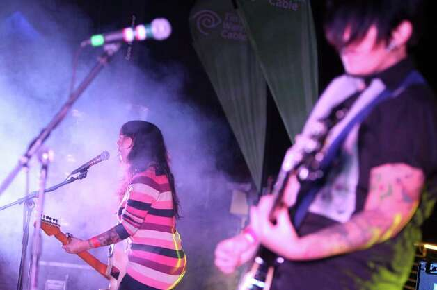 Guitar and vocalist Nina Diaz and bassist Jenn Alva of San Antonio band Girl in a Coma perform during Echale at the Pearl Brewery, Saturday, October 29, 2011. (Jennifer Whitney/ Special to the San Antonio Express-News) Photo: Jennifer Whitney, Special To The Express-News / special to the Express-News