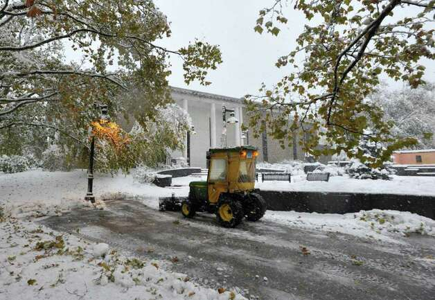 A plow clears the walkway in front of Danbury Library on Saturday, Oct. 29, 2011. Photo: Jason Rearick