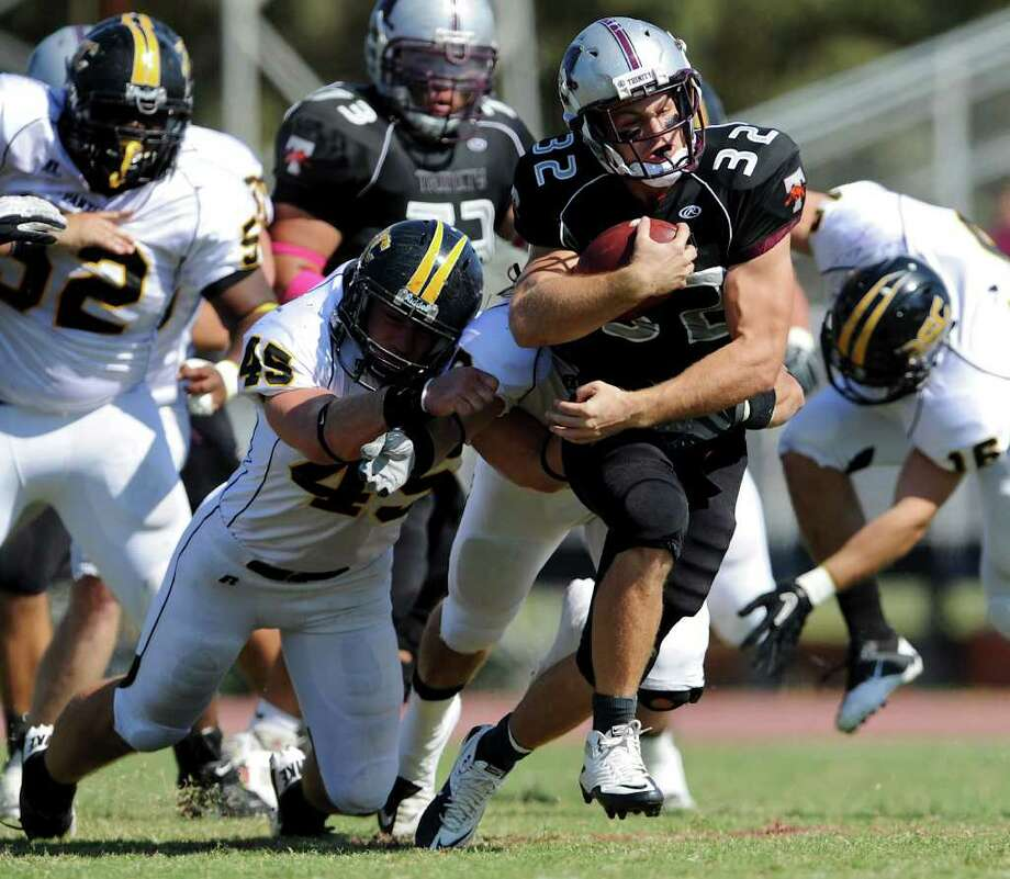 Trinity running back Patrick Granchelli (32) runs past several defenders during a NCAA Division III football game between Birmingham Southern and Trinity University In San Antonio, Texas on October 28, 2011.