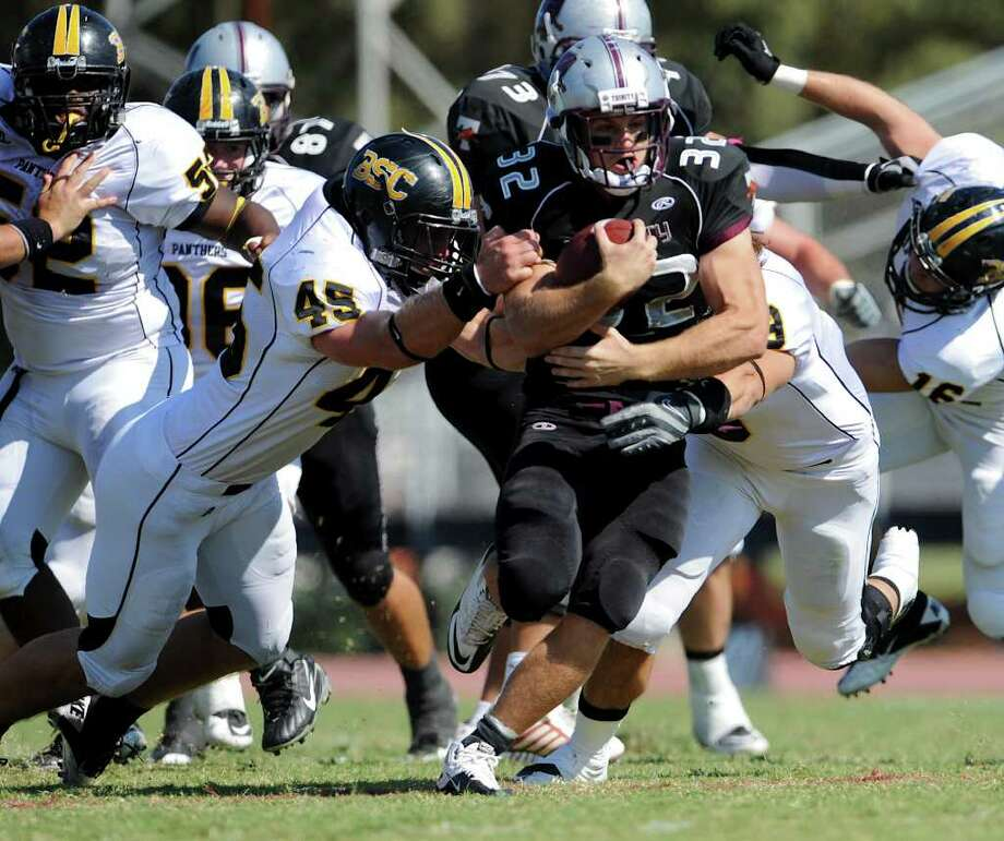 Trinity running back Patrick Granchelli (32) breaks tackles on a carry up the middle during a NCAA Division III football game between Birmingham Southern and Trinity University In San Antonio, Texas on October 28, 2011.