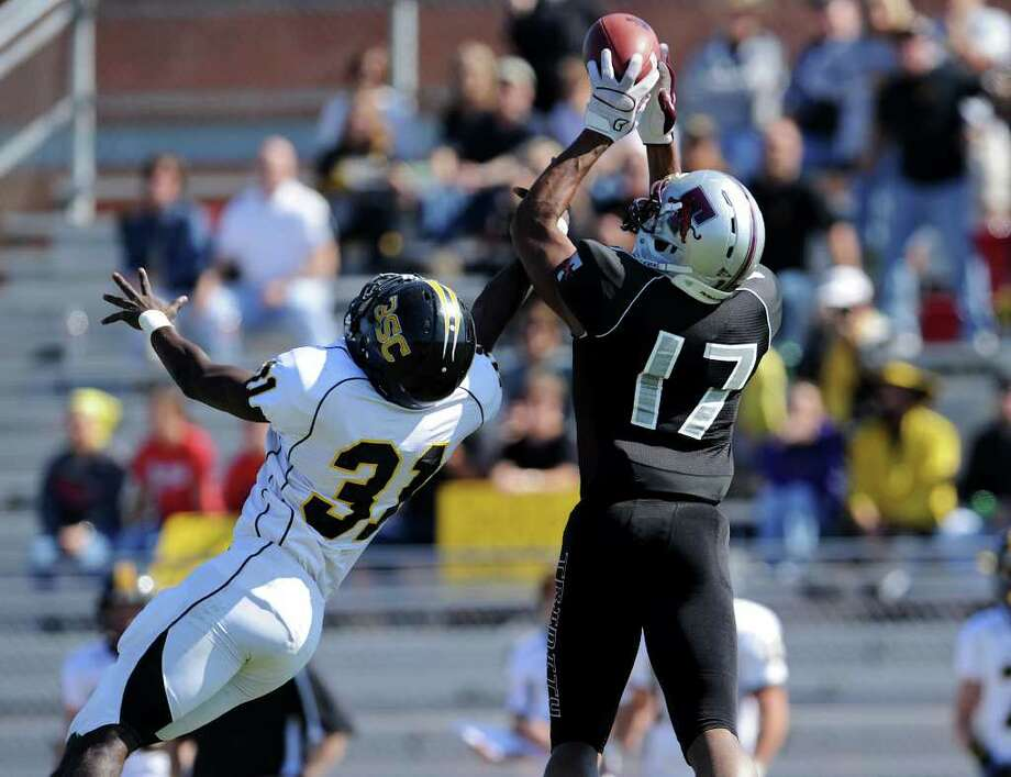 Trinity's Jon Jackson (17) catches a pass over Birmingham Southern's Jeffery Steele (31) during a NCAA Division III football game between Birmingham Southern and Trinity University In San Antonio, Texas on October 28, 2011. John Albright / Special to the Express-News. Photo: Express-News