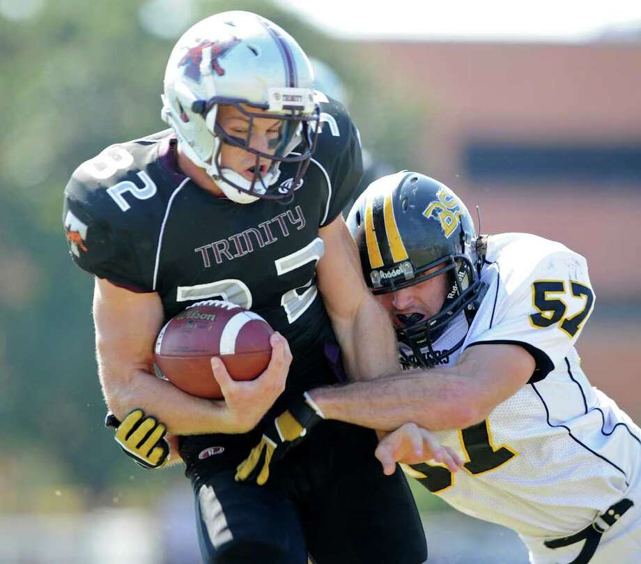 Trinity running back Patrick Granchelli (32) is hit has he scores a touchdown during a NCAA Division III football game between Birmingham Southern and Trinity University In San Antonio, Texas on October 28, 2011.