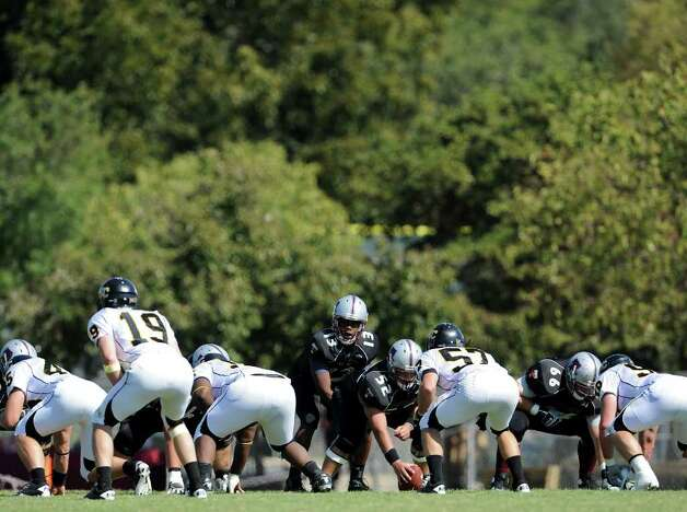 The Trinity Tigers line up on the line of scrimmage during a NCAA Division III football game between Birmingham Southern and Trinity University In San Antonio, Texas on October 28, 2011.