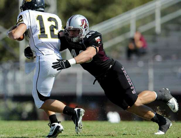 Trinity's Thomas Puskarich makes a tackle on the quarterback during a NCAA Division III football game between Birmingham Southern and Trinity University In San Antonio, Texas on October 28, 2011.