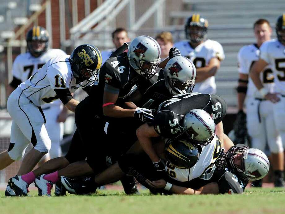Trinity defenders gang tackle during a NCAA Division III football game between Birmingham Southern and Trinity University In San Antonio, Texas on October 28, 2011.