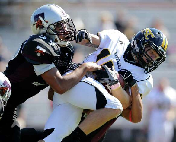 Trinity's Jai Boatman (39) tackles Birmingham Southern's Chad King (15) during a NCAA Division III football game between Birmingham Southern and Trinity University In San Antonio, Texas on October 28, 2011.
