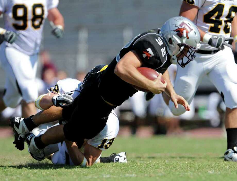 Trinity running back Patrick Granchelli (32) dives for extra yards during a NCAA Division III football game between Birmingham Southern and Trinity University In San Antonio, Texas on October 28, 2011.