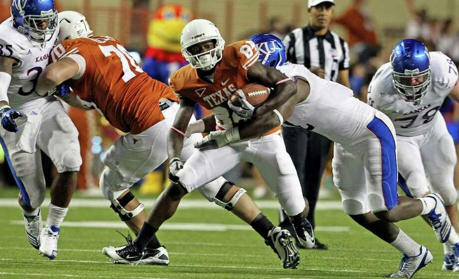 Marquise Goodwin tries an end around in the first half as the Longhorns play Kansas at Darrell K. Memorial Stadium on  October 29, 2011.  Tom Reel/Staff Photo: TOM REEL, Express-News / © 2011 San Antonio Express-News