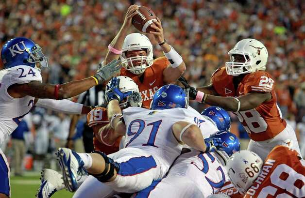 UT quarterback David Ash tries to push the ball over the goal line as he hits a pile of lineman with Malcolm Brown helping as the Longhorns play Kansas at Darrell K. Memorial Stadium on  October 29, 2011.  Tom Reel/Staff Photo: TOM REEL, Express-News / © 2011 San Antonio Express-News
