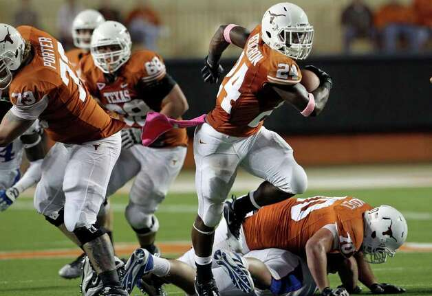UT running back Joe Bergeron takes advantage of good blocking to score in the fourth quarter as the Longhorns play Kansas at Darrell K. Memorial Stadium on  October 29, 2011.  Tom Reel/Staff Photo: TOM REEL, Express-News / © 2011 San Antonio Express-News