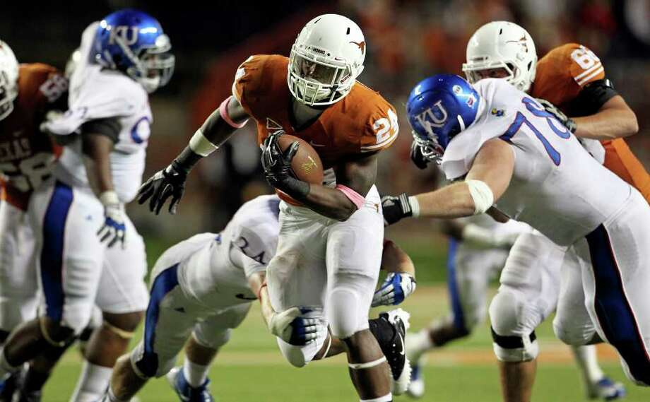 Joe Bergeron puts on a rushing show in the second half as the Longhorns play Kansas at Darrell K. Memorial Stadium on  October 29, 2011.  Tom Reel/Staff Photo: TOM REEL, Express-News / © 2011 San Antonio Express-News