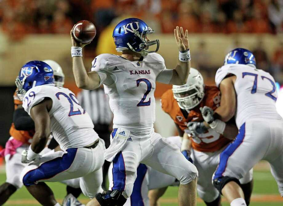 Kansas quarterback Jordan Webb looks for a receiver in the fourth quarter as the Longhorns play Kansas at Darrell K. Memorial Stadium on  October 29, 2011.  Tom Reel/Staff Photo: TOM REEL, Express-News / © 2011 San Antonio Express-News