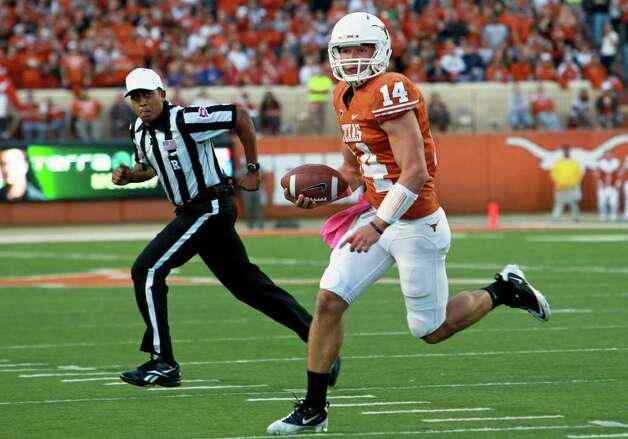 UT quarterback David Ash heads for a touchdown in the first quarter as the Longhorns play Kansas at Darrell K. Memorial Stadium on  October 29, 2011.  Tom Reel/Staff Photo: TOM REEL, Express-News / © 2011 San Antonio Express-News