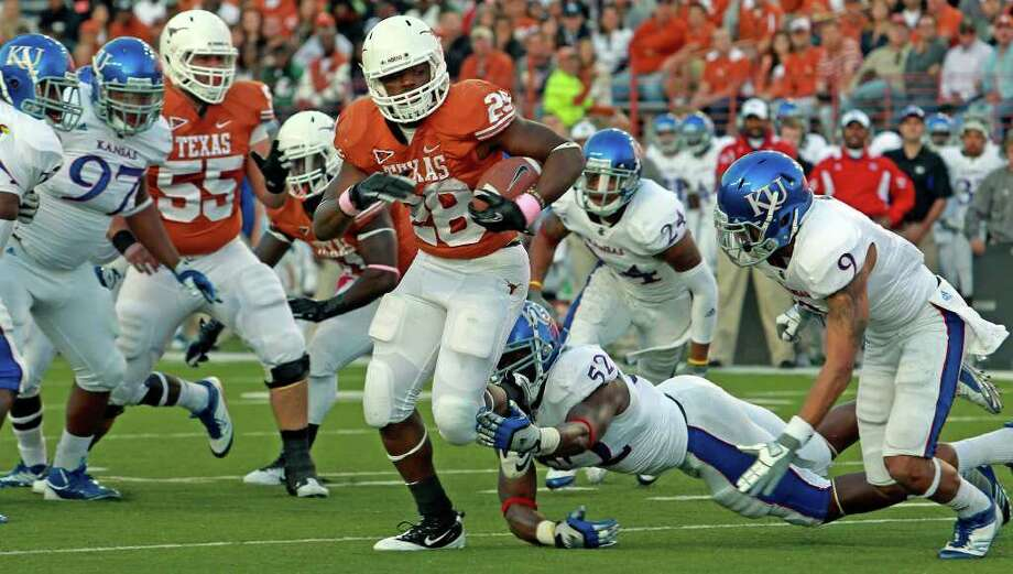 UT running back Malcolm Brown gets past the last defender on a touchdown run in the first quarter as the Longhorns play Kansas at Darrell K. Memorial Stadium on  October 29, 2011.  Tom Reel/Staff Photo: TOM REEL, Express-News / © 2011 San Antonio Express-News