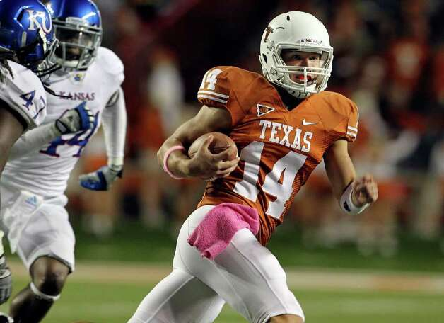 UT quarterback David Ash breaks into the open as the Longhorns play Kansas at Darrell K. Memorial Stadium on  October 29, 2011.  Tom Reel/Staff Photo: TOM REEL, Express-News / © 2011 San Antonio Express-News