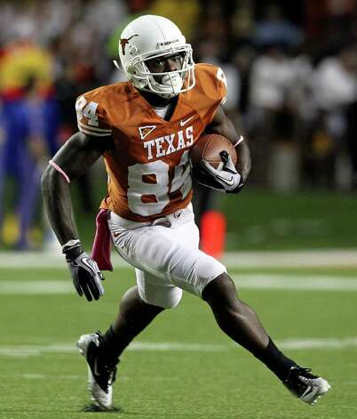 Marquise Goodwin looks for room on an end around as the Longhorns play Kansas at Darrell K. Memorial Stadium on  October 29, 2011.  Tom Reel/Staff Photo: TOM REEL, Express-News / © 2011 San Antonio Express-News