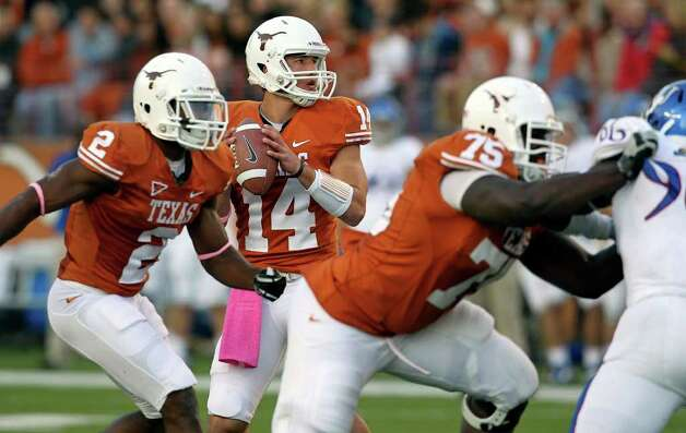 UT quarterback David Ash waits behind protection to throw as the Longhorns play Kansas at Darrell K. Memorial Stadium on  October 29, 2011.  Tom Reel/Staff Photo: TOM REEL, Express-News / © 2011 San Antonio Express-News