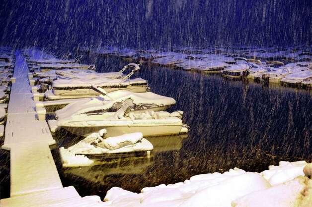 Snow falls hard on boats still in the water at Echo Bay Marina in Brookfield Saturday night, Oct. 29, 2011. Photo: Carol Kaliff