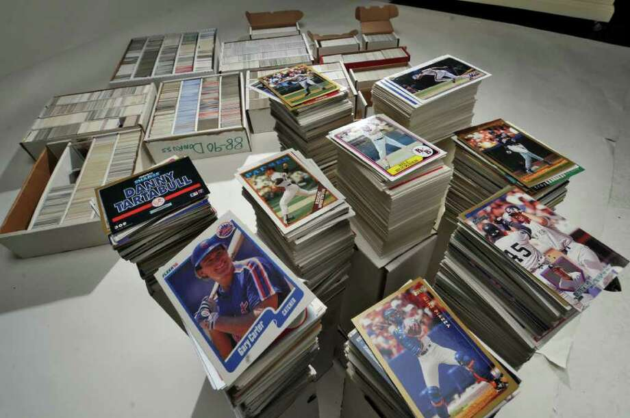 Baseball cards and cards from other sports, from the 1980's and 1990's, in the Times Union photography studio on Wednesday Oct. 26, 2011 in Colonie, NY. (Philip Kamrass / Times Union ) Photo: Philip Kamrass / 00015130A
