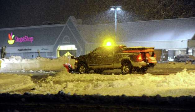 A snowplow clears snow from the Stop 'N Shop parking lot on Newtown Road in Danbury Saturday night, Oct. 29, 2011. Photo: Carol Kaliff