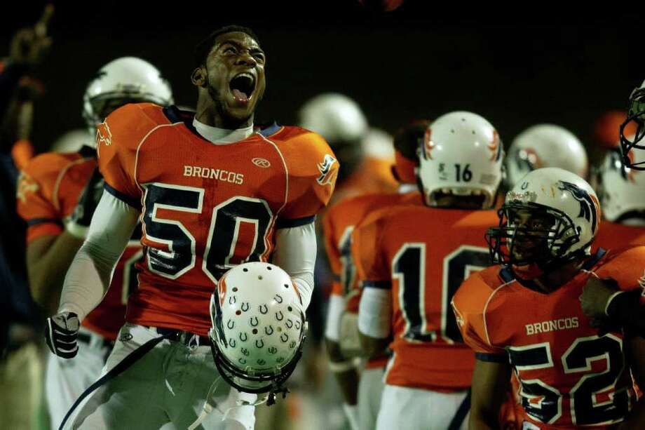 Bush linebacker Henry Offiah (50) celebrates a Broncos kick return for a touchdown during the third quarter of a high school football game against Travis at  Mercer Stadium, Saturday, Oct. 29, 2011, in Sugar Land. Photo: Smiley N. Pool, Houston Chronicle / © 2011  Houston Chronicle