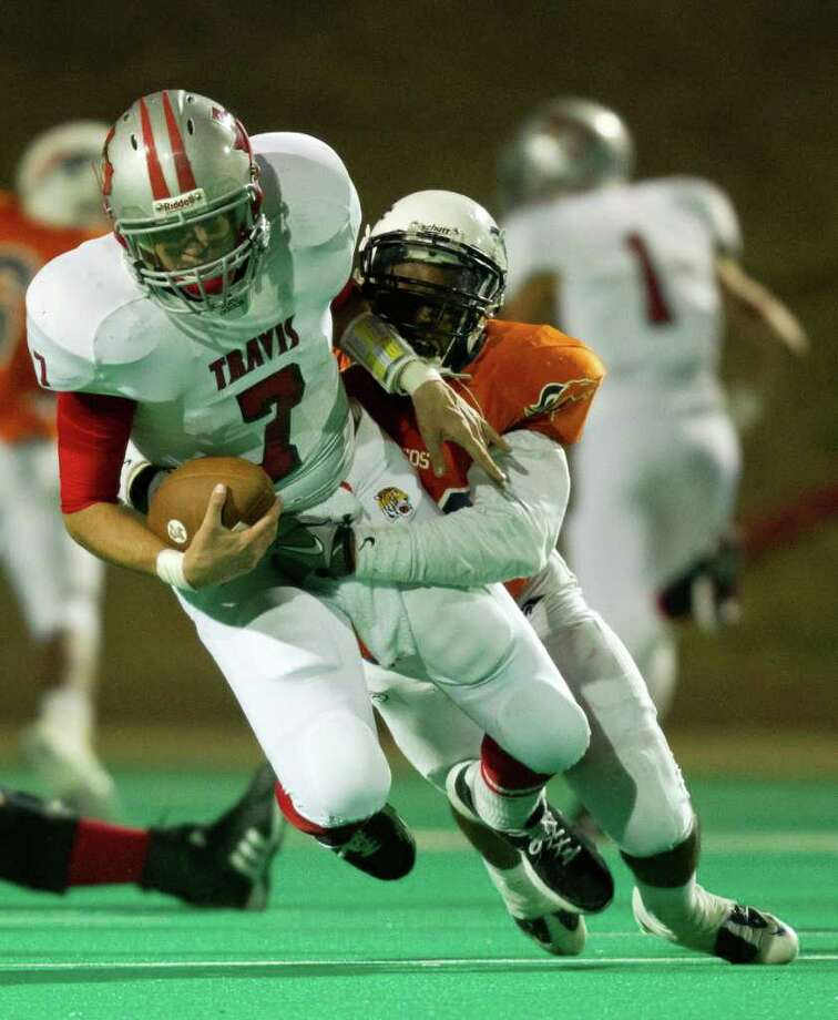 Travis quarterback Kyle Coulter (7) is sacked by Bush linebacker Dontae Armstrong (44) during the third quarter of a high school football game at  Mercer Stadium, Saturday, Oct. 29, 2011, in Sugar Land. Photo: Smiley N. Pool, Houston Chronicle / © 2011  Houston Chronicle
