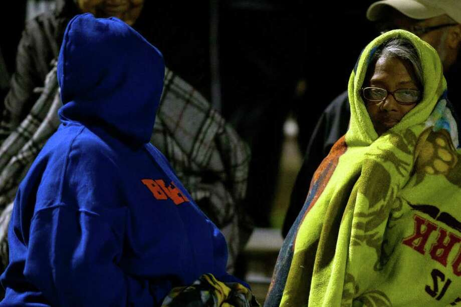Bush fans huddle under blankets on a chilly evening while watching their team defeat Travis in a high school football game at  Mercer Stadium, Saturday, Oct. 29, 2011, in Sugar Land. Photo: Smiley N. Pool, Houston Chronicle / © 2011  Houston Chronicle